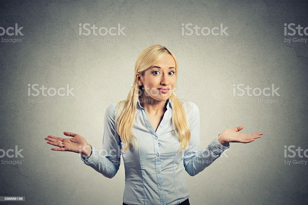 Confused clueless woman arms out shrugs shoulders stock photo