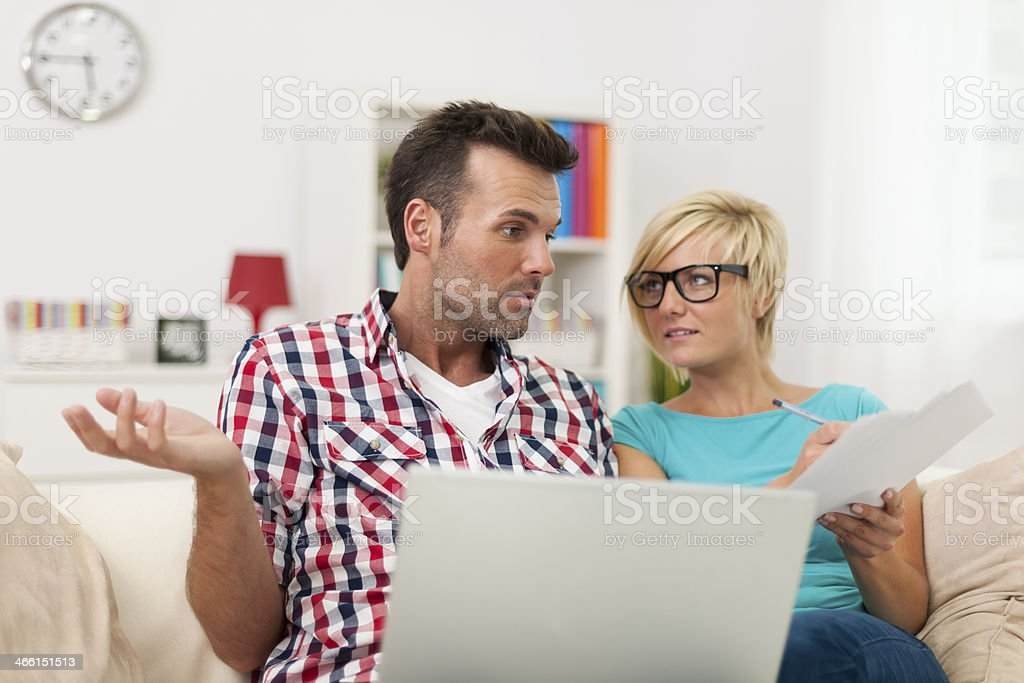 Confused couple doing their accounts stock photo