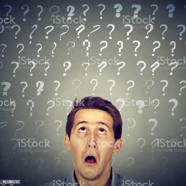 Confused curious shocked man thinking looking up has many questions picture id661885732?b=1&k=6&m=661885732&s=612x612&h=kl8xz3rngntnxnryyetlmlkizk4xxonyaqliuijdqek=
