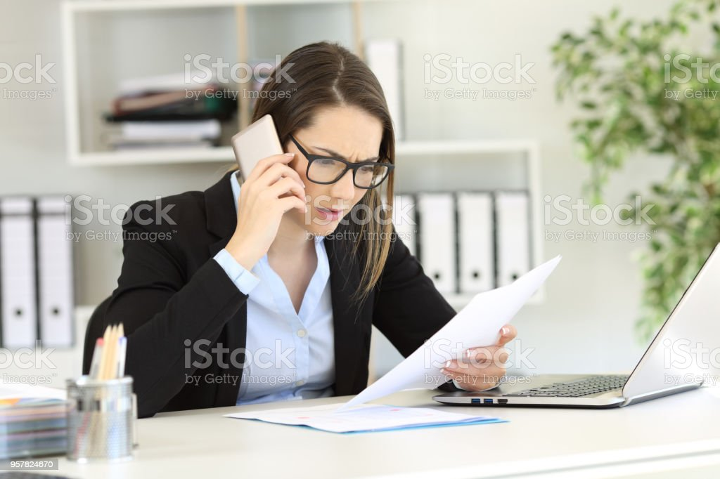 Confused customer calling support service at office stock photo