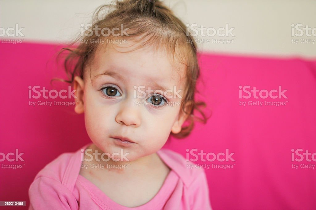 Confused face expression from a little baby girl stock photo