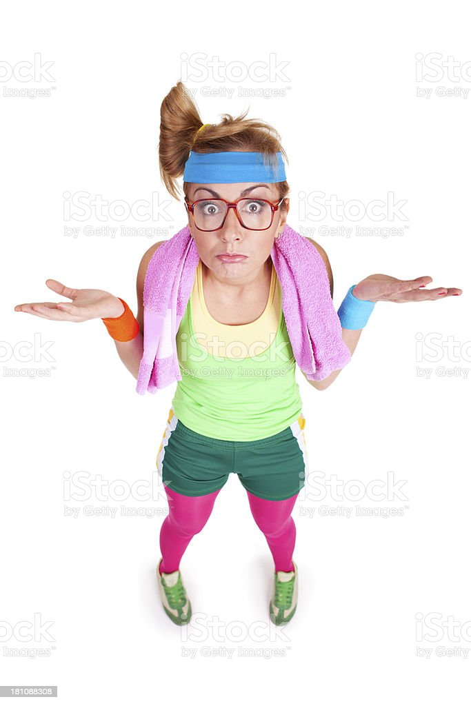 Confused fitness girl with glasses standing isolated on white background royalty-free stock photo