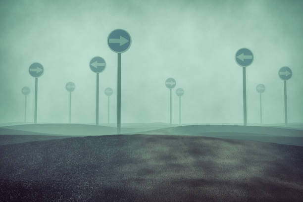 Confused foggy landscape with traffic signs stock photo