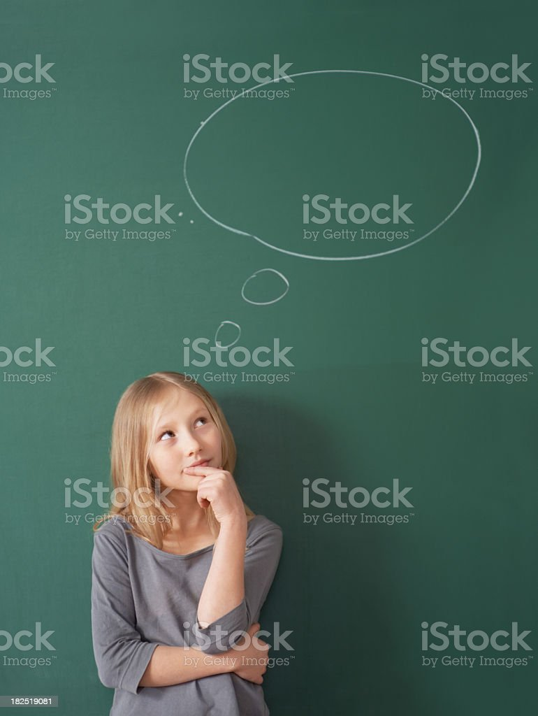 Confused girl having a thought bubble against chalkboard royalty-free stock photo