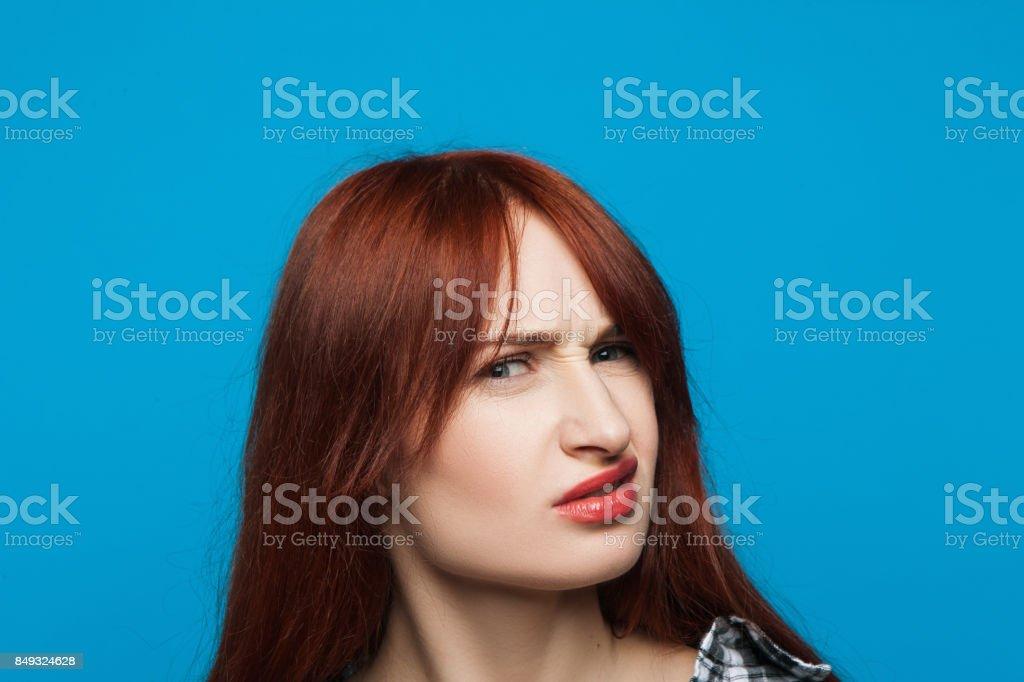 Confused girl portrait. Distrustful woman stock photo
