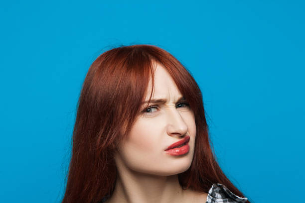 confused girl portrait. distrustful woman - disdainful stock pictures, royalty-free photos & images