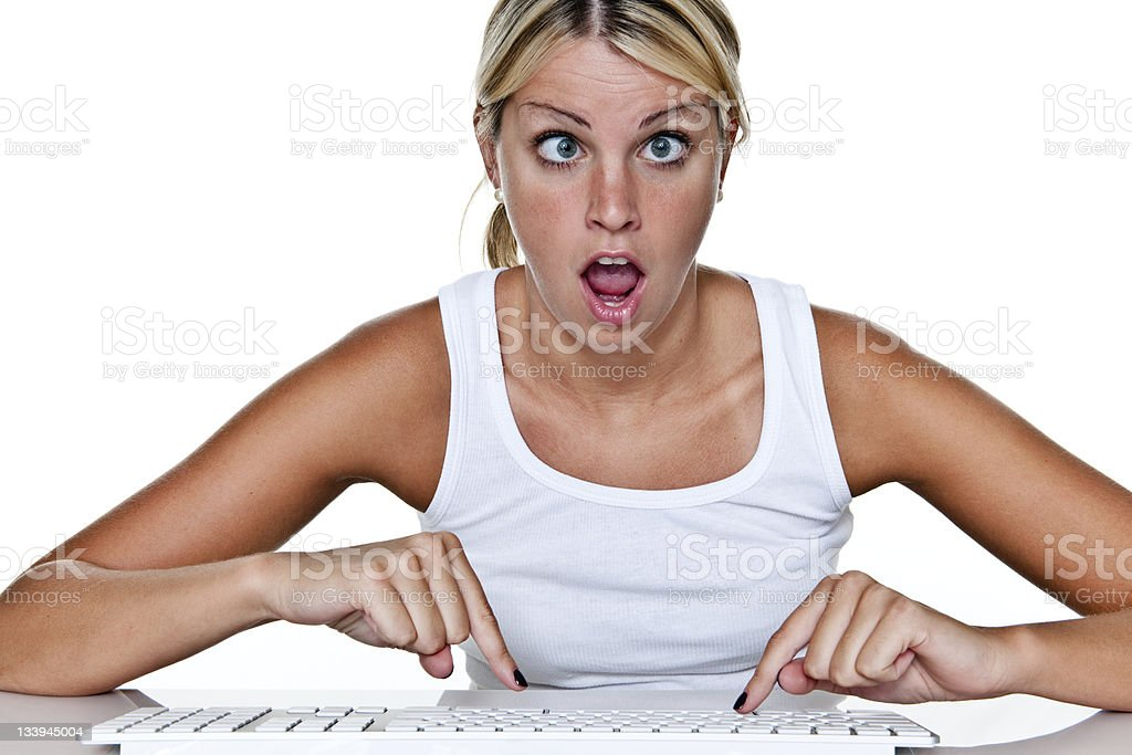 Confused girl using computer stock photo
