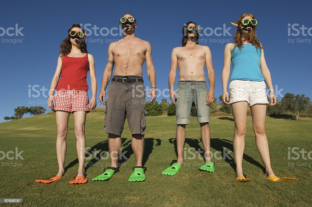 confused group in snorkeling gear on a golf course foto stock royalty-free