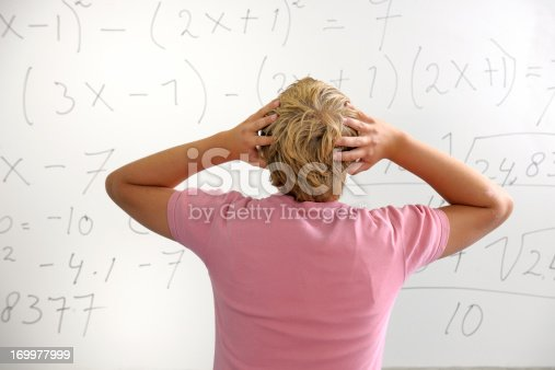 istock confused high school student in front of whiteboard 169977999