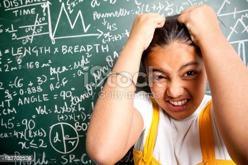 istock Confused Indian Girl Student with Mathematics Problems 182702526