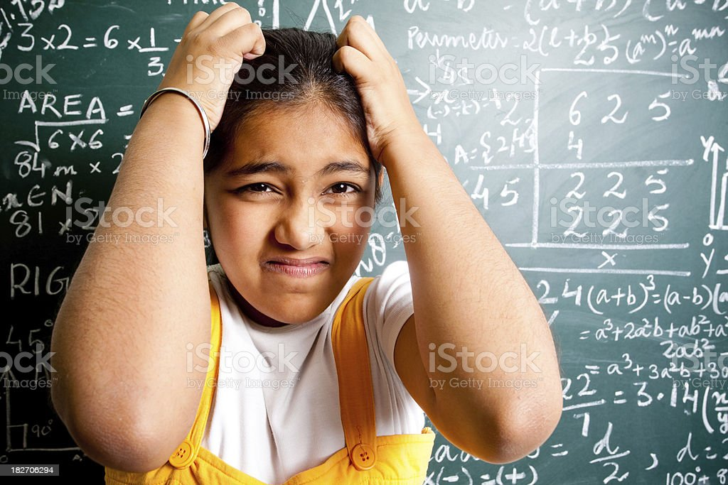 Confused Indian Girl Student with Mathematics Problems royalty-free stock photo
