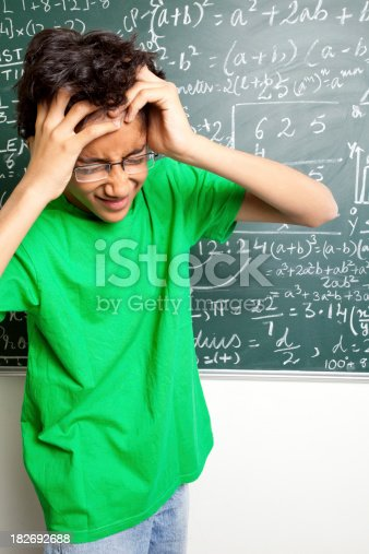 istock Confused Indian Teenager Student with Mathematics Problems 182692688