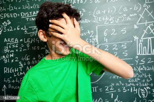 istock Confused Indian Teenager Student with Mathematics Problems 182703038