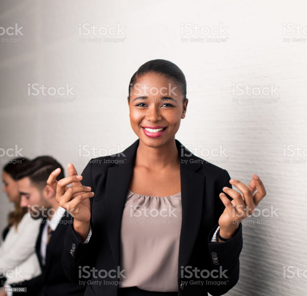 Confused latin business woman facing the camera with hands held up stock photo