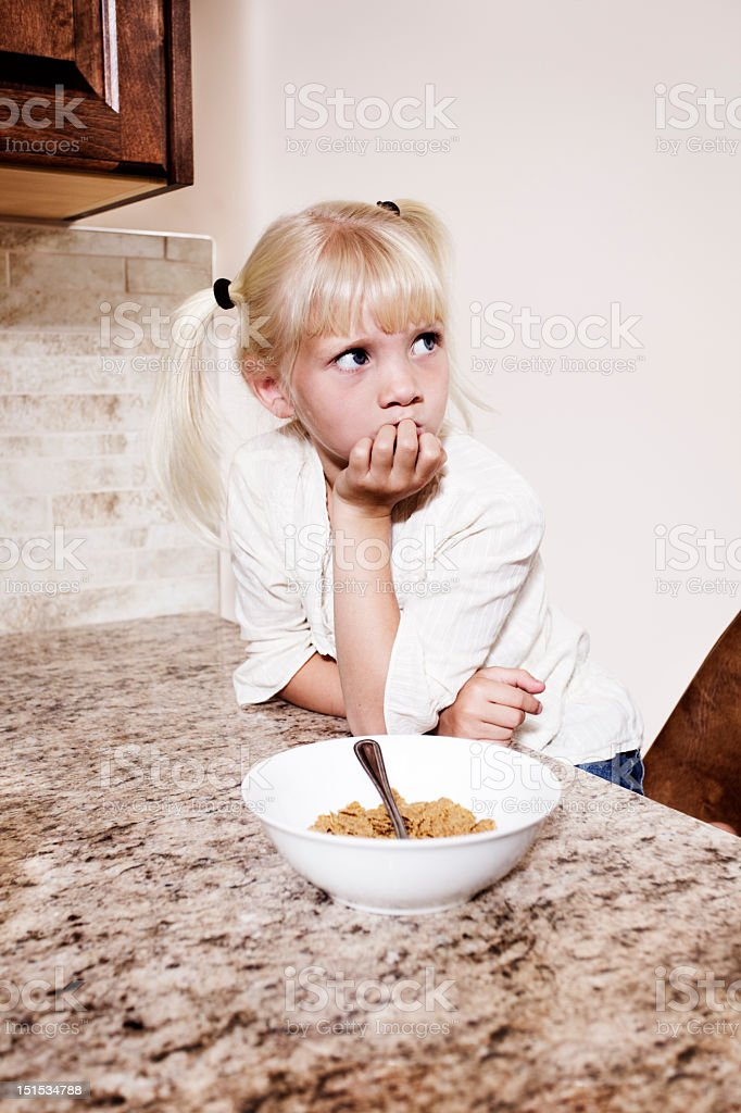 Confused little girl stock photo
