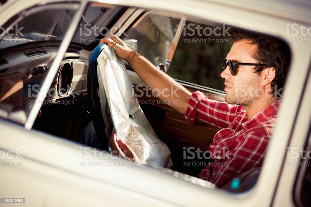 Confused Man Reading Map stock photo