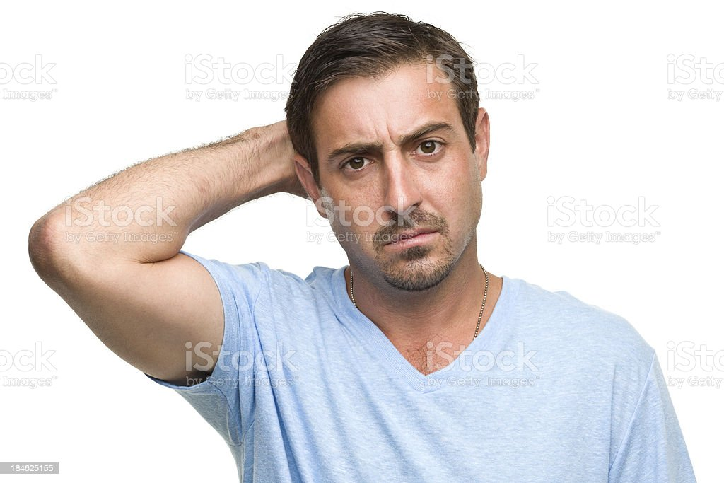 Confused Man Scratches Head royalty-free stock photo