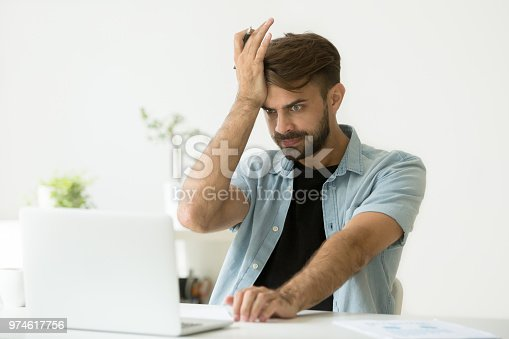 857213750istockphoto Confused man stressed about performing mistake in report 974617756