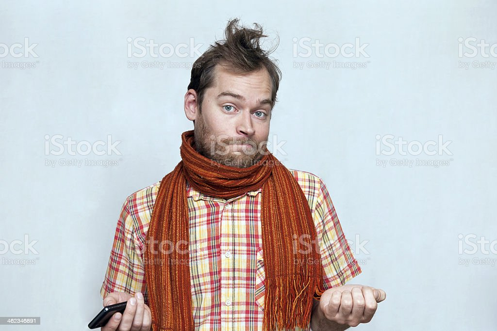 Confused Man With Phone royalty-free stock photo