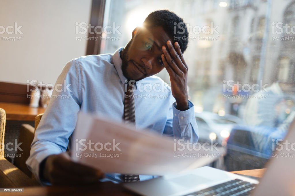 Confused manager in cafe stock photo