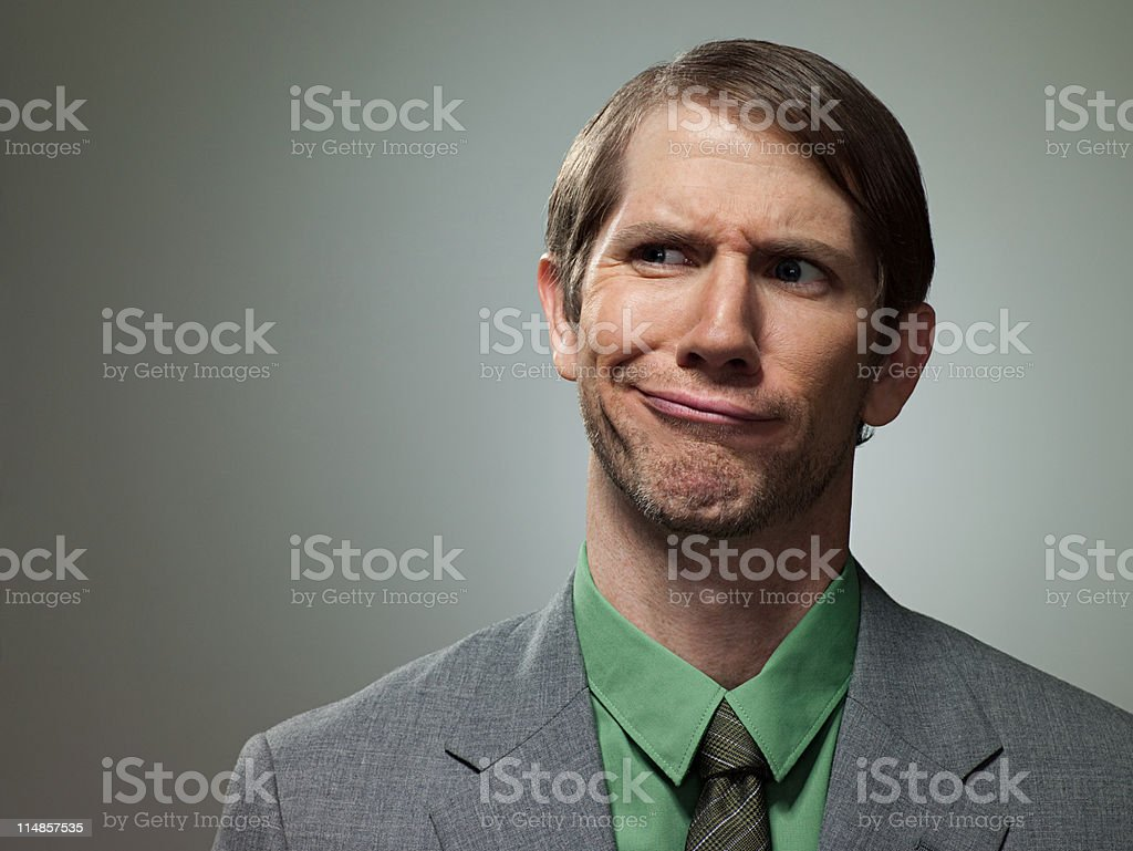 Confused mid adult businessman, portrait stock photo