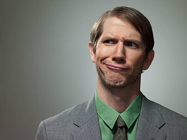 Confused mid adult businessman, portrait stock photo