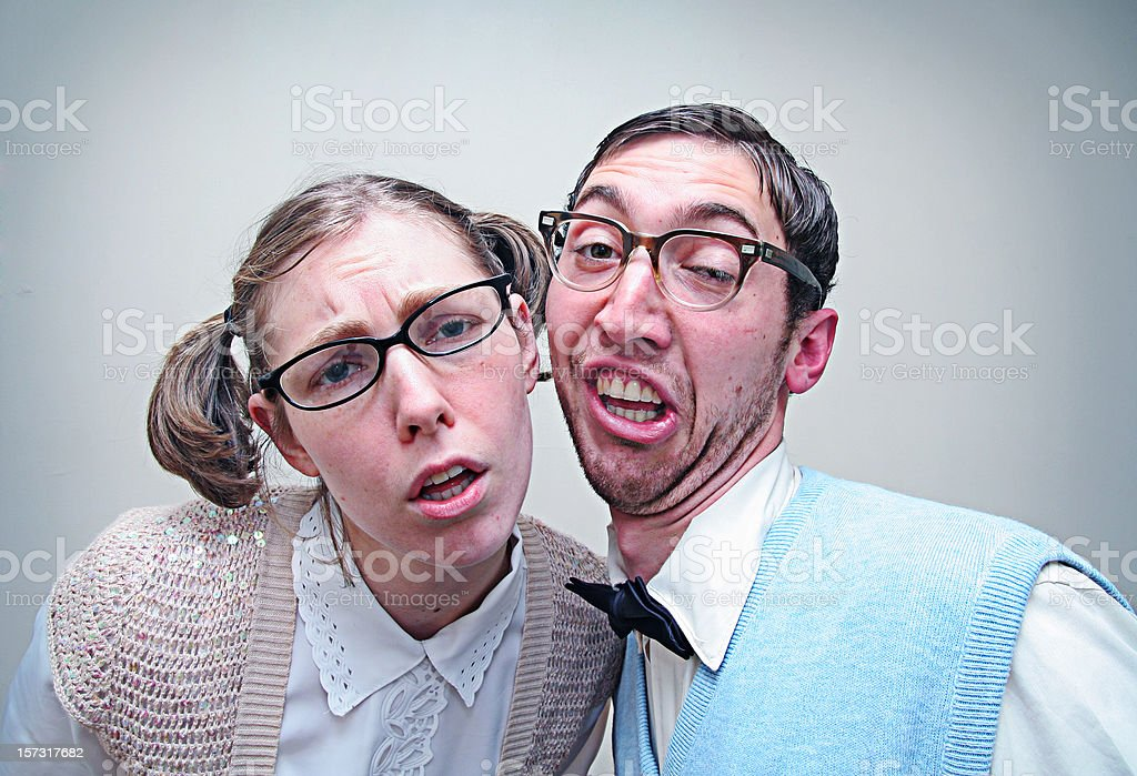 Confused Nerd Young Man and Woman stock photo