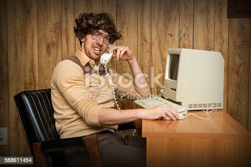 a 1980's themed silly image of a shaggy haired office or home office worker is confused while on the telephone.  wood paneling in the background