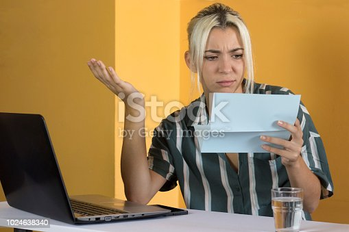 istock Confused office worker reading documents 1024638340