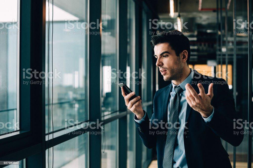 Confused phone communication stock photo