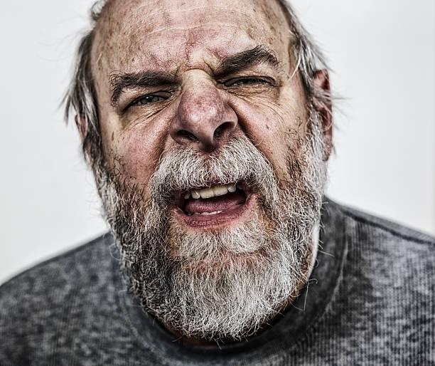 confuso senior adulto homem close-up - boca suja imagens e fotografias de stock