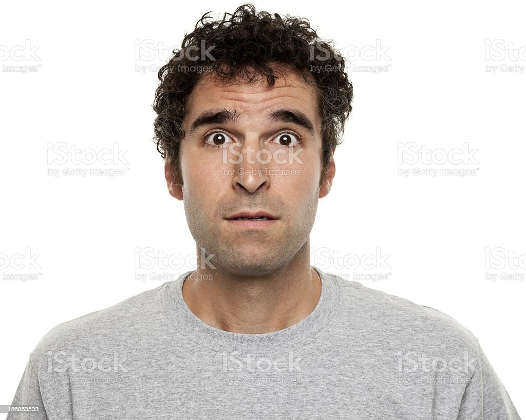 Confused, Surprised Man Raises Eyebrows royalty-free stock photo