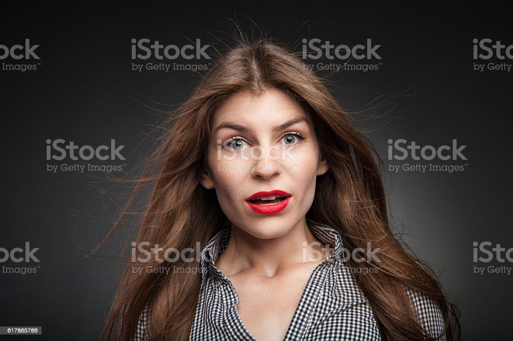 Confused woman got really surprised. stock photo