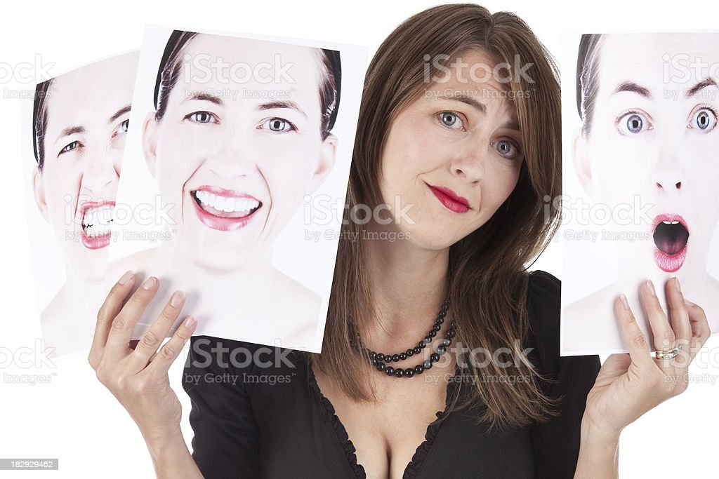 Confused Woman Holding Photographs of Her Emotions royalty-free stock photo