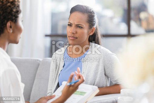 istock Confused woman listens to counselor 903353774