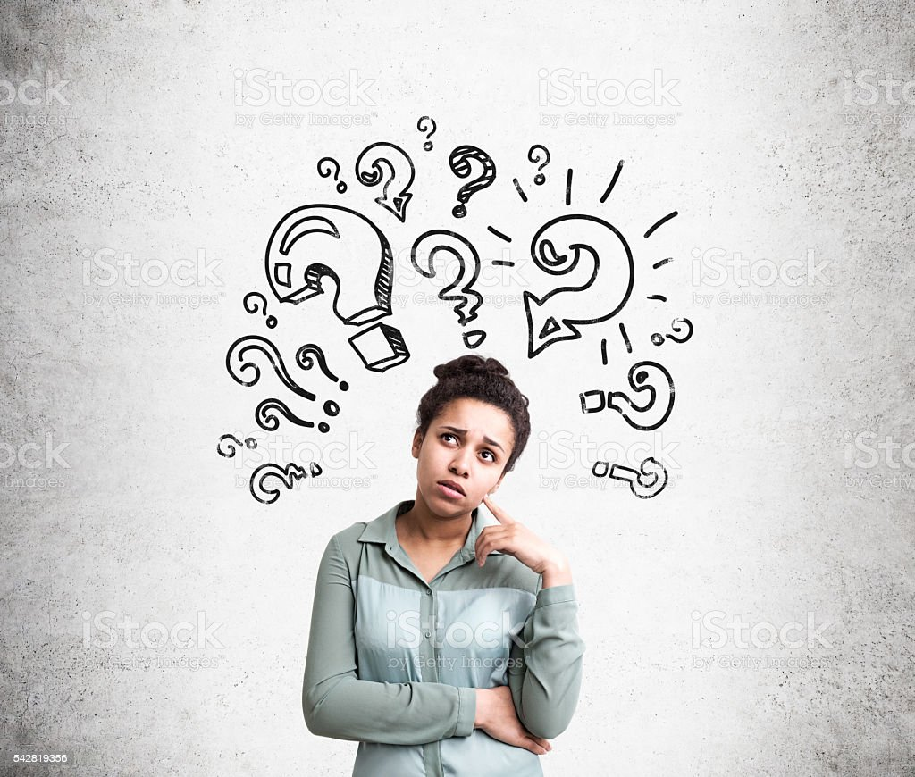Confused woman with questions stock photo