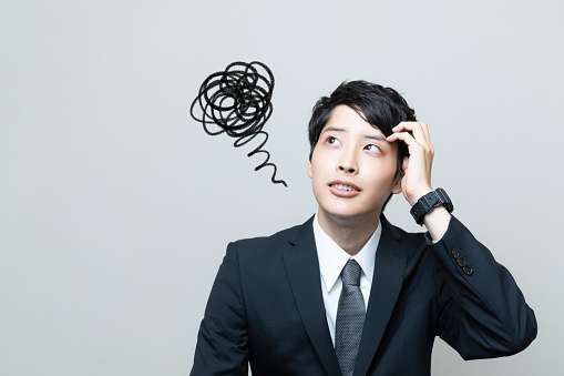istock Confused young asian businessman. 1035819148