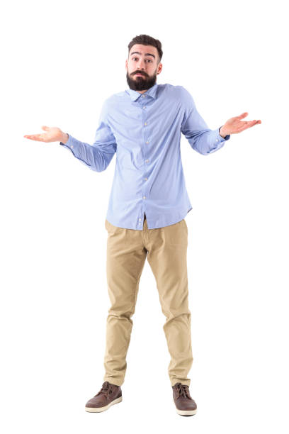 Confused young bearded businessman shrugging shoulders looking at camera Confused young bearded businessman shrugging shoulders looking at camera. Full body length portrait isolated on white studio background. shrugging stock pictures, royalty-free photos & images