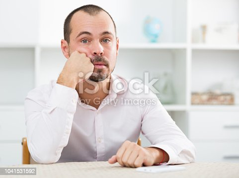 istock Confused young man at workplace 1041531592