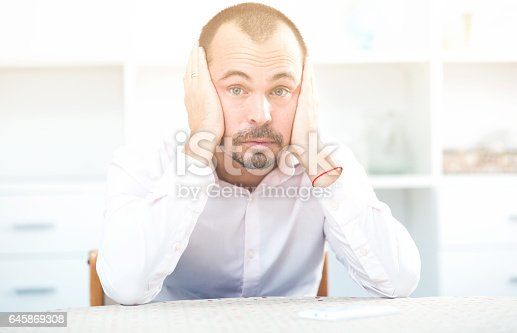 istock Confused young man at workplace 645869308