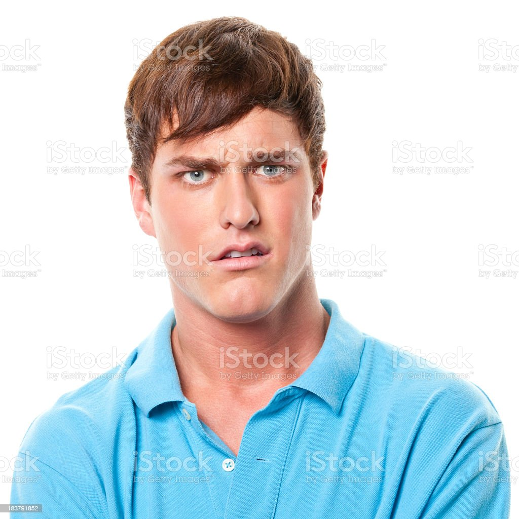 Confused Young Man Frowning stock photo
