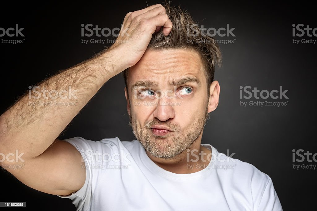 Confused young man stock photo