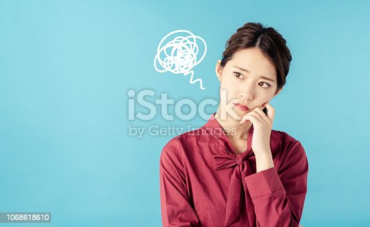 istock Confused young woman. 1068618610