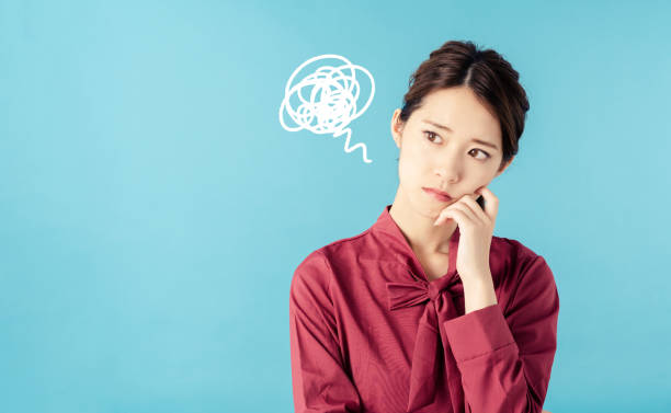 Confused young woman. stock photo
