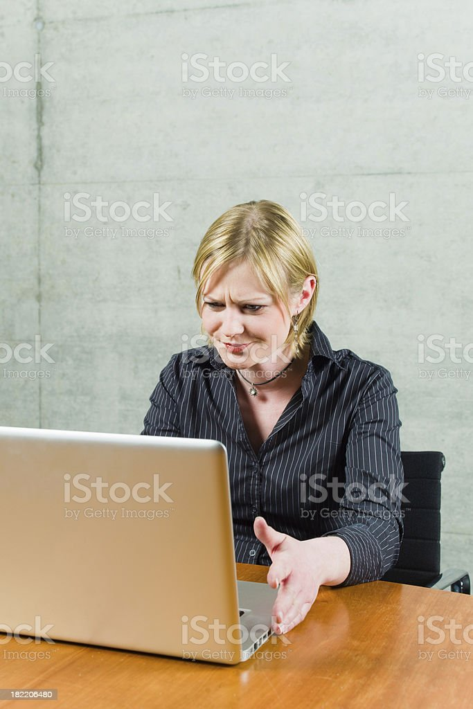 Confused Young Woman with Notebook Problems royalty-free stock photo