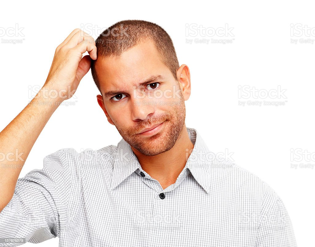 Confusion - Young man scratching his head on white royalty-free stock photo