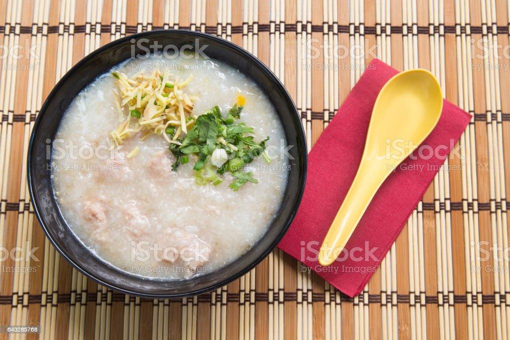 Congee, Rice porridge, Rice gruel, Rice soup on wooden background stock photo