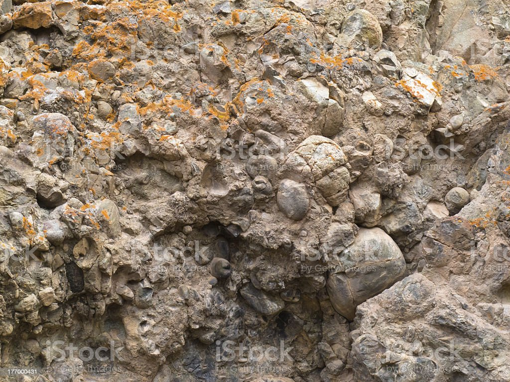 Conglomerate of sedimentary deposit plus lichens stock photo