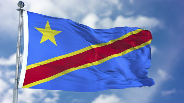 congo democratic republic flag in a blue sky - republic of the congo stock photos and pictures