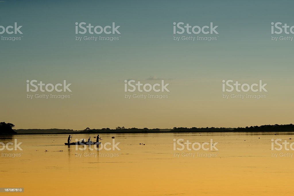 Congo river: Pirogue (dugout canoe) in the last daylight stock photo